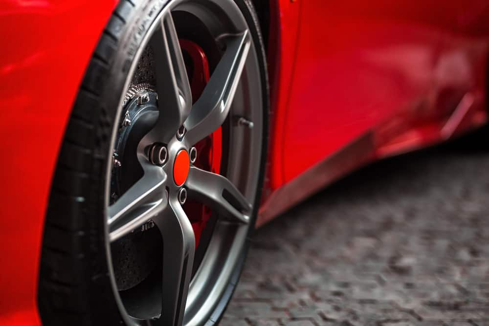 close up of a  tire on a red car