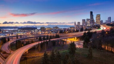 seatle landscape at dusk with skyline and freeway with cars with washington insurance