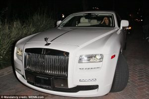 Kim Kardashian in her Rolls Royce - Courtesy of : http://www.dailymail.co.uk/tvshowbiz/article-2193721/Got-Kim-Kardashian-makes-car-lovers-jealous-tweets-pictures-150-000-Mercedes-G63.html