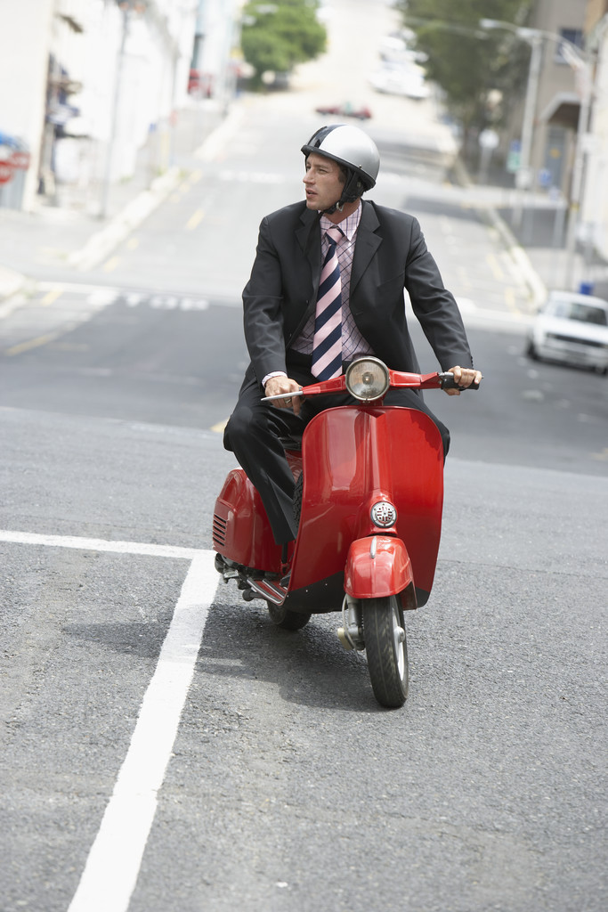 Businessman on Moped