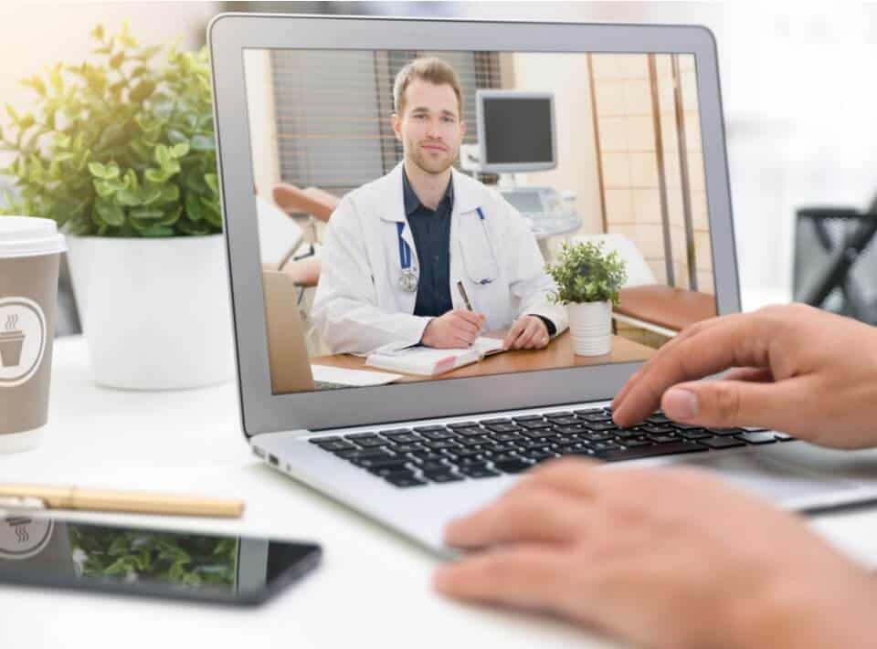 patient talking to doctor using laptop video chat with telemedicine